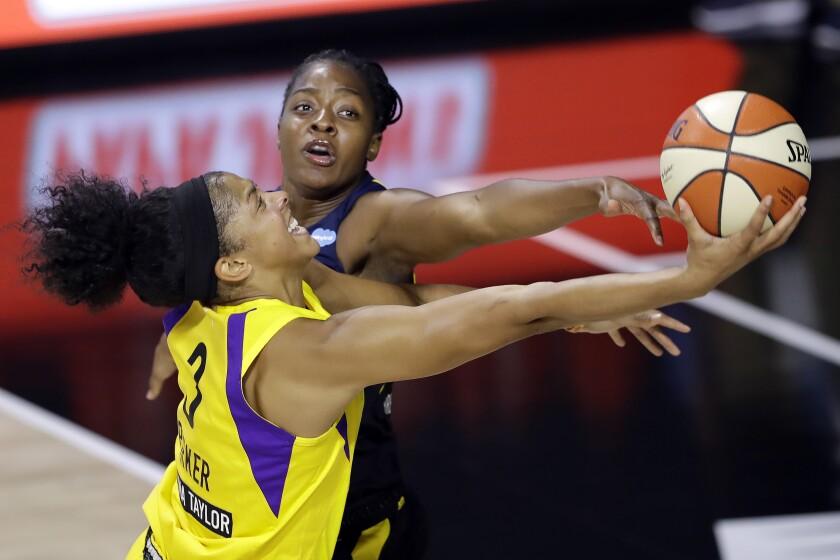 Sparks forward Candace Parker goes for a layup around Indiana Fever forward Stephanie Mavunga.