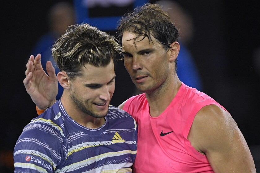 Austria's Dominic Thiem, left, is congratulated Jan. 29 by Spain's Rafael Nadal after winning their quarterfinal match at the Australian Open tennis championship in Melbourne.