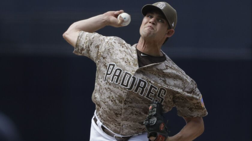 Padres relief pitcher Robert Stock works against an Arizona Diamondbacks batter during the eighth inning of a baseball game Sunday, July 29, 2018, in San Diego.