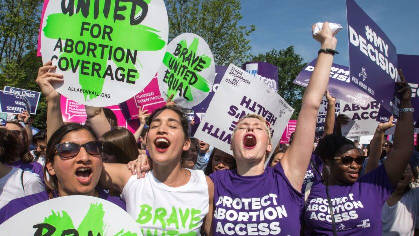 Abortion rights activists rejoice in front of the U.S. Supreme Court in Washington, as the justices strike down parts of a Texas anti-abortion restriction law known last year.