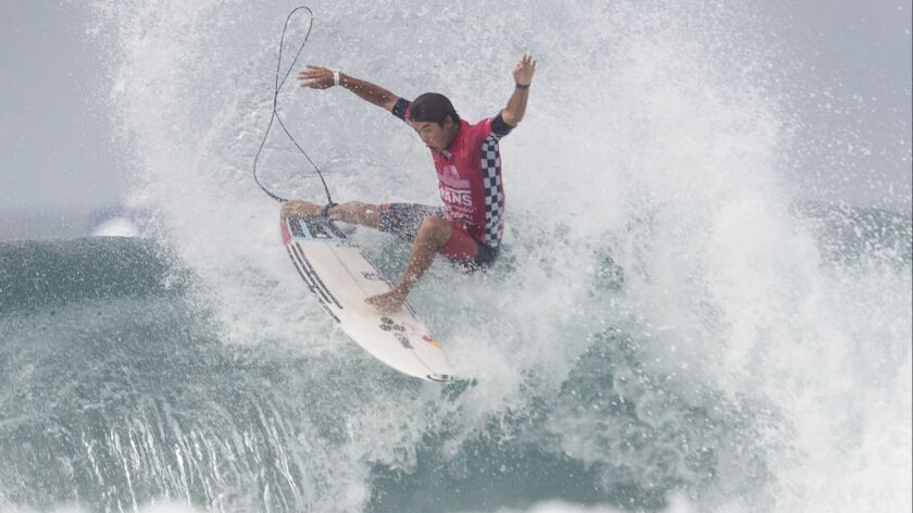 Huntington Beach's Kanoa Igarashi surfs in heat one of round four during the annual Vans US Open of