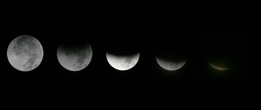 This combination of Dec. 10, 2011, photos shows the different stages of the moon during a lunar eclipse as seen from the Griffith Observatory in Los Angeles.
