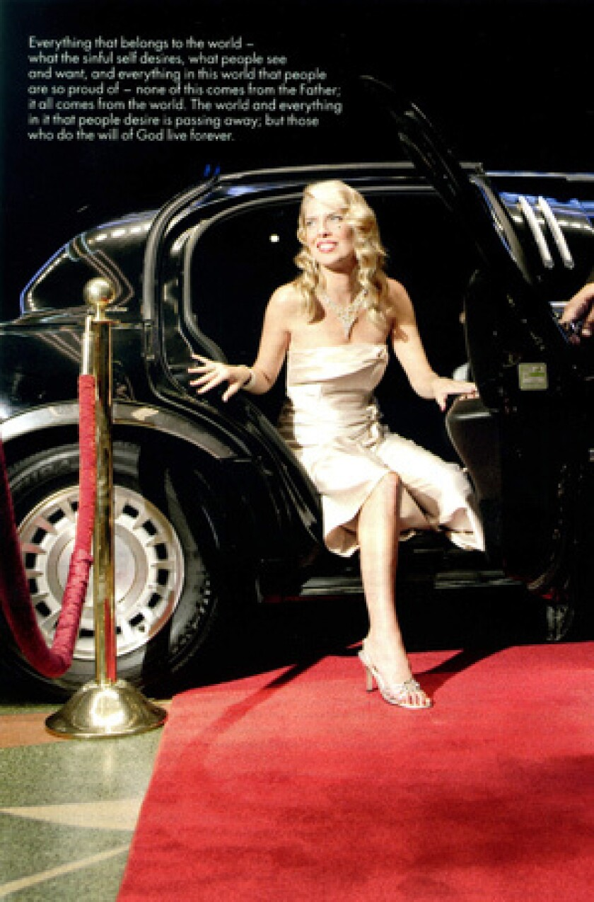 A red carpet scene is used to help send a message about materialism and desires.