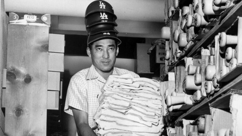 FILE - 5/28/1965 - Dodgers equipment manager, Nobe Kawano, is shown with just a portion of the gear