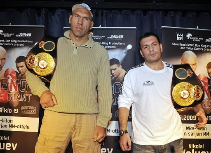 Russian heavyweight boxer and current holder of the World Boxing Association (WBA) title Nikolai Valuev, left,  and Ruslan Chagaev of Uzbekistan pose during a press conference in Helsinki, Finland on  Wednesday May 27, 2009. Valuev and Chagaev will fight each other in the title fight at the end of