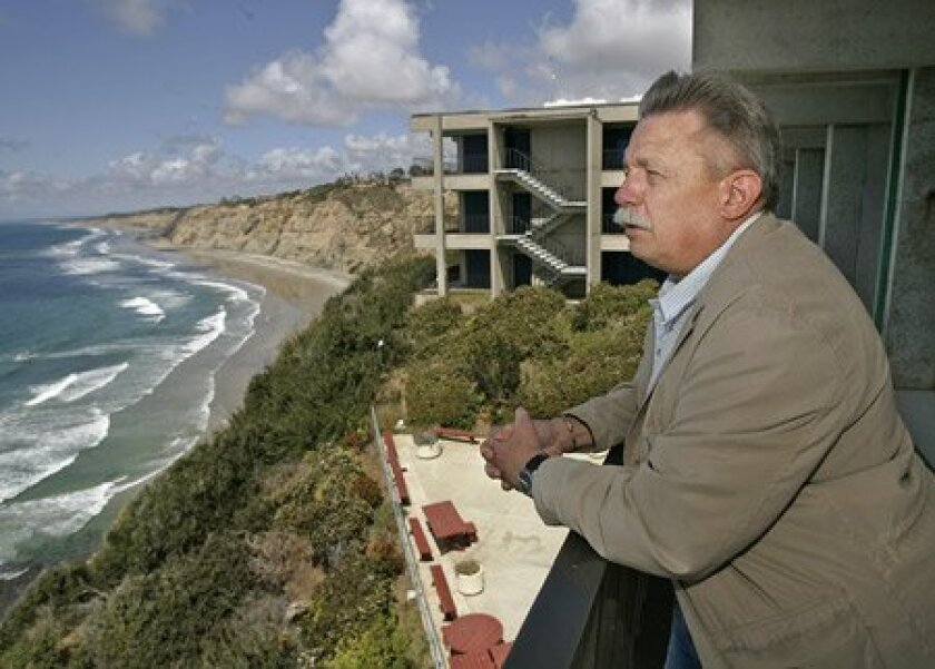 Roger Hewitt, an assistant director at the Southwest Fisheries Science Center, looked out from one of the buildings compromised by the eroding ocaen bluffs on which they were built in the mid-1960s.   (Nancee E. Lewis / U-T)