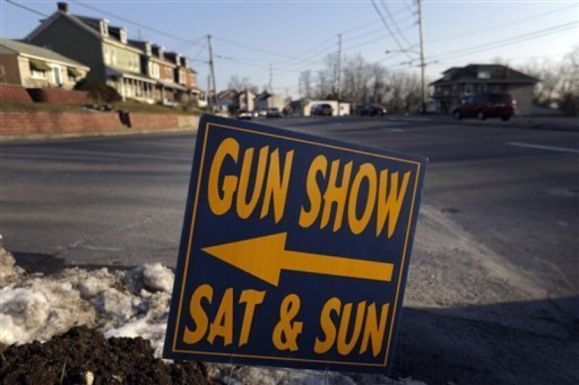 A sign is posted for an upcoming gun show, Friday, Jan. 4, 2013, in Leesport, Pa. Gun advocates arenít backing down from their insistence on the right to keep and bear arms. But heightened sensitivities and raw nerves since the Newtown, Conn. shooting are softening displays at gun shows and even leading officials and sponsors to cancel the popular exhibitions altogether. (AP Photo/Matt Rourke)
