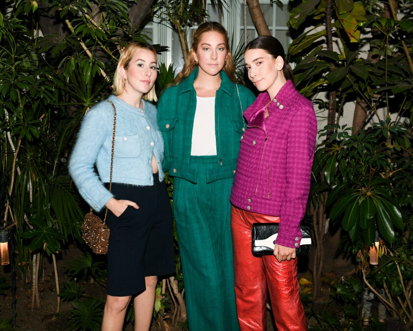 Este Haim, Danielle Haim and Alana Haim of the pop band Haim at the Chanel dinner in West Hollywood.