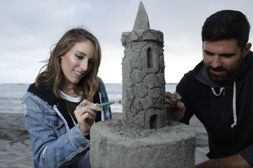 Daters build a sand castle