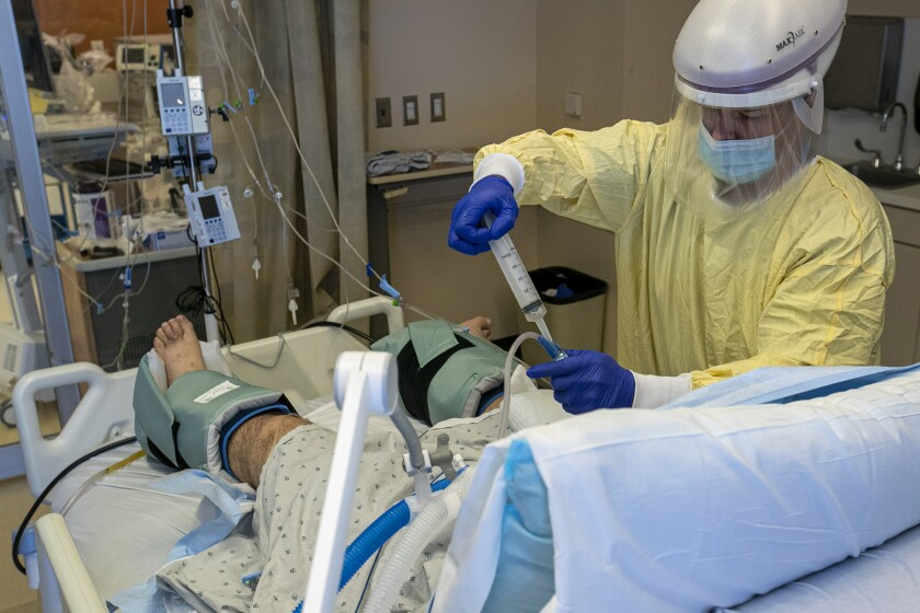 ICU nurse Jason Shackleton attends to a covid19 patient at Arrowhead Regional Medical Center in Colton.