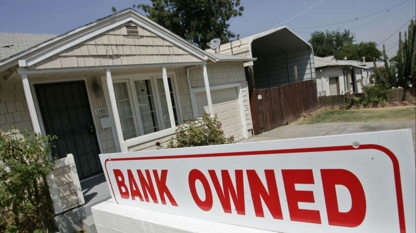 FILE- This Aug. 14, 2007, file photo shows a sign of a house under foreclosure in Antioch, Calif. As