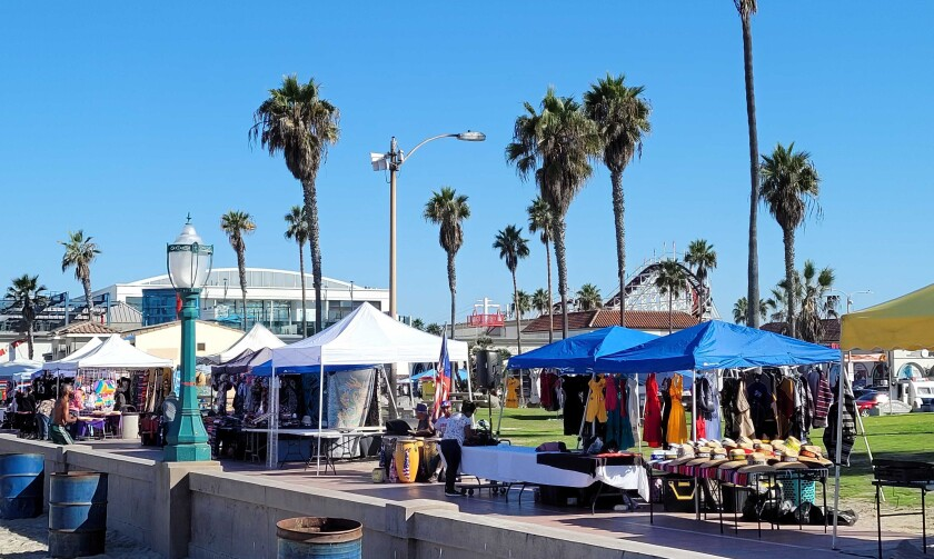 Vendors tents have been popping up in city parks, such as these in Mission Beach Park on Oct. 13, 2021.
