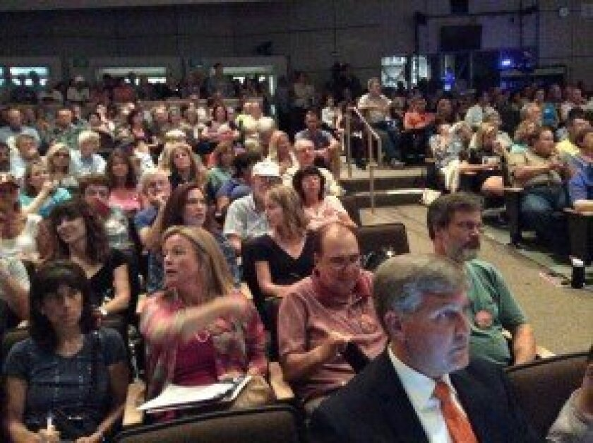 A huge crowd, including Supervisor Dave Roberts, front, turned out at the Carmel Valley Community Planning Board's Aug. 28 meeting on One Paseo. Photos by Karen Billing