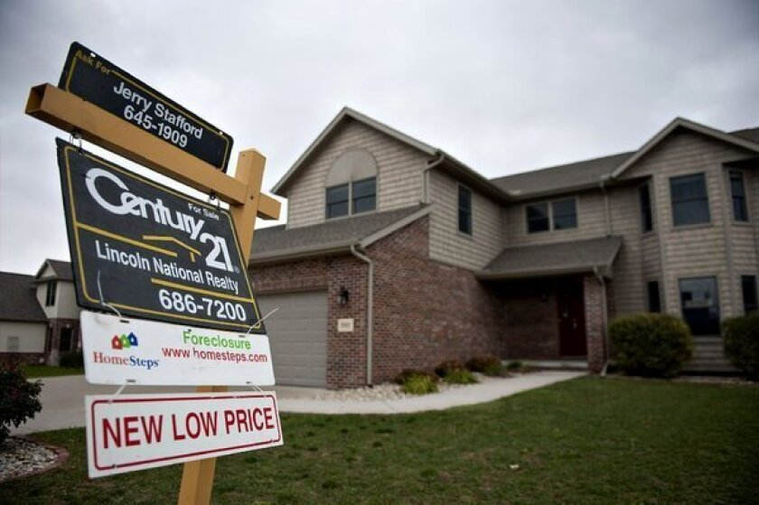 Signs like this one in front of a home in Peoria, Ill., last month are getting to be a less common sight.