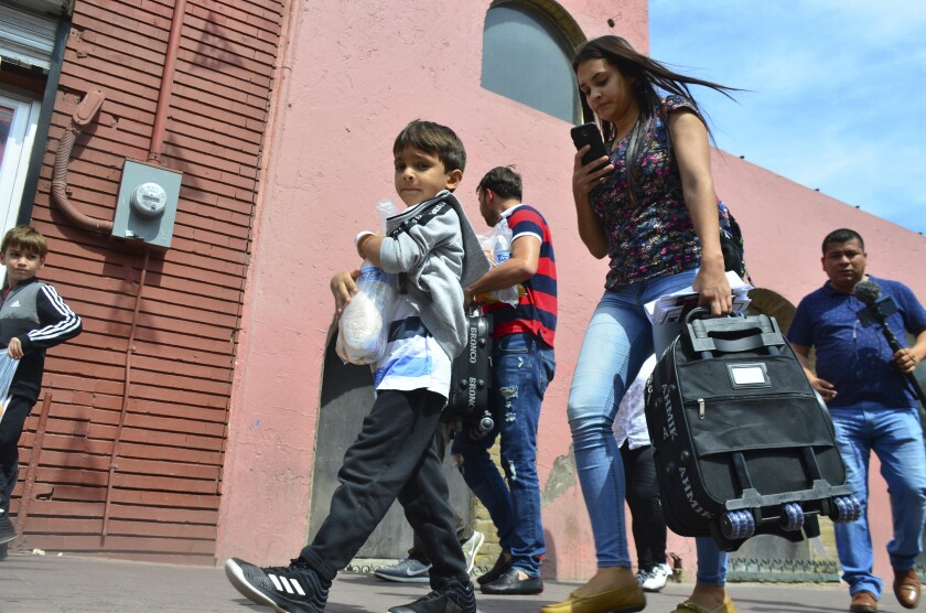 Lucia Ascencio of Venezuela carries a suitcase after she, her husband and two children were returned to Nuevo Laredo, Mexico, as part of the first group of migrants sent back to the Mexican state of Tamaulipas under the so-called Remain in Mexico program for U.S. asylum seekers on Tuesday, July 9, 2019. This is part of what the proposal for A New Vision of the Border wants to change.
