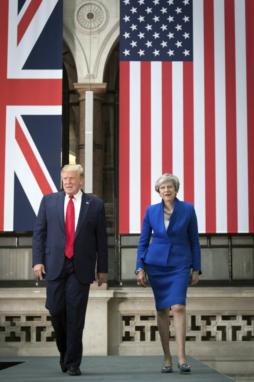Britain's Prime Minister Theresa May and US President Donald Trump arrive to take part in a joint pr