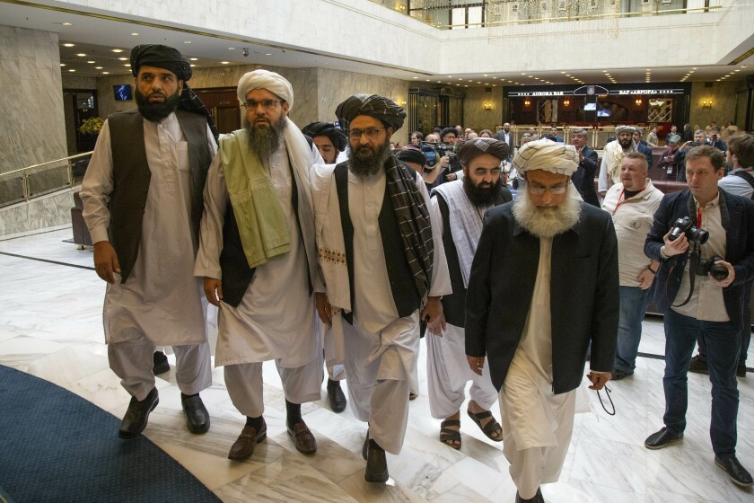 Mullah Abdul Ghani Baradar, the Taliban's top political leader, third from left, arrives with other members of the Taliban delegation for talks in Moscow in May 2019.