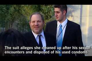 Harvey Weinstein ex-assistant sues, describing unwanted touching, naked dictation and used condoms