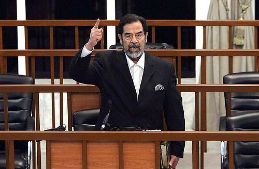 Former Iraqi President Saddam Hussein yells at the court as he receives his verdict.