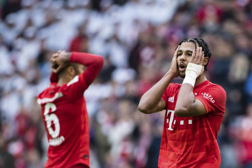 In this Saturday, Oct. 5, 2019 photo Bayern's player Serge Gnabry, right, reacts after the German Bundesliga socvcer match between FC Bayern Munich and 1899 Hoffenheim in Munich, Germany. Bayern Munich's first defeat of the season has exposed old problems that a 7-2 rout of Tottenham had helped cover up only days before. (Matthias Balk/dpa via AP)