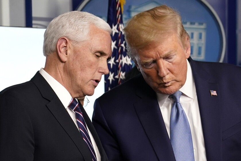 Donald Trump and Mike Pence at a recent coronavirus task force news conference.