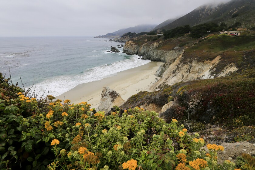 Rugged bluffs, rocky headlands and a secluded beach mark the scenic Big Sur coastline.