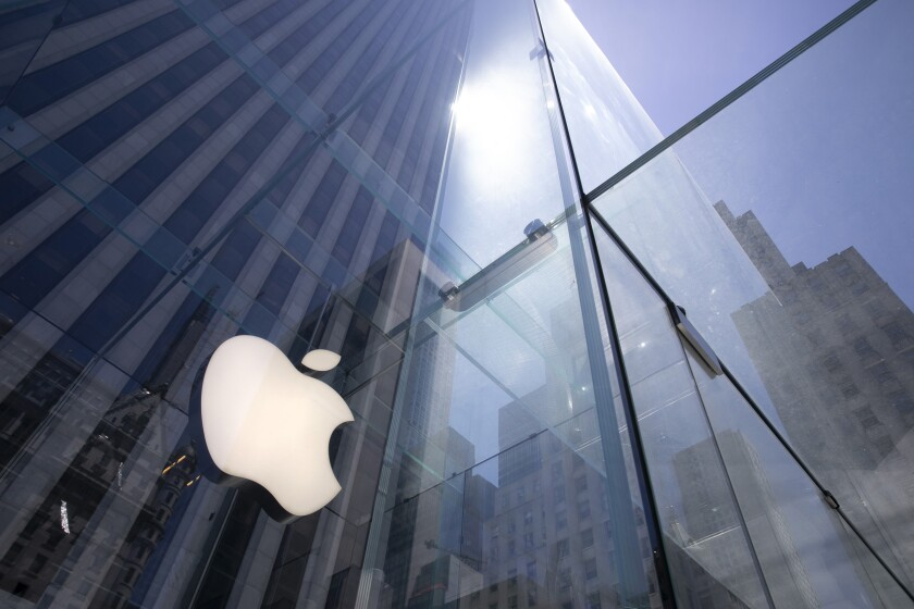 FILE - In this Tuesday, June 16, 2020 file photo, the sun is reflected on Apple's Fifth Avenue store in New York. In the years since Barack Obama and Joe Biden left the White House, the tech industry's political fortunes have flipped. Facebook, Google, Amazon and Apple have come under scrutiny from Congress, federal regulators, state attorneys general and European authorities. (AP Photo/Mark Lennihan, File)