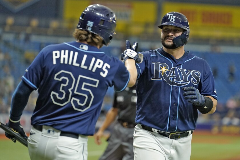 Tampa Bay Rays' Mike Zunino, right, celebrates with Brett Phillips after his solo home run off Seattle Mariners relief pitcher Drew Steckenrider during the sixth inning of a baseball game Wednesday, Aug. 4, 2021, in St. Petersburg, Fla. (AP Photo/Chris O'Meara)