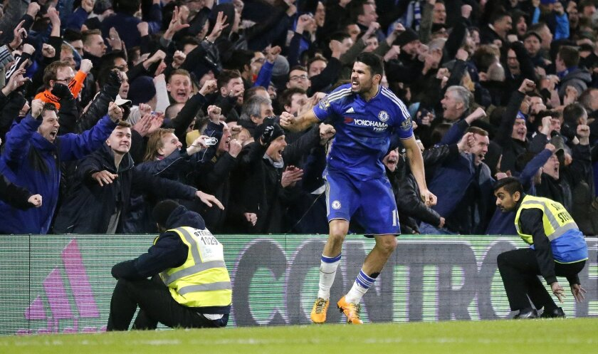 Chelsea's Diego Costa celebrates after scoring a goal during the English Premier League soccer match between Chelsea and Manchester United at Stamford Bridge stadium in London, Sunday, Feb. 7, 2016.  (AP Photo/Frank Augstein)