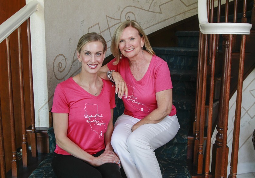 Vembra Holnagel, right, and her daughter Kianne Farmer, of the Shades of Pink Foundation California, pose for photos at Holnagel's Encinitas home.