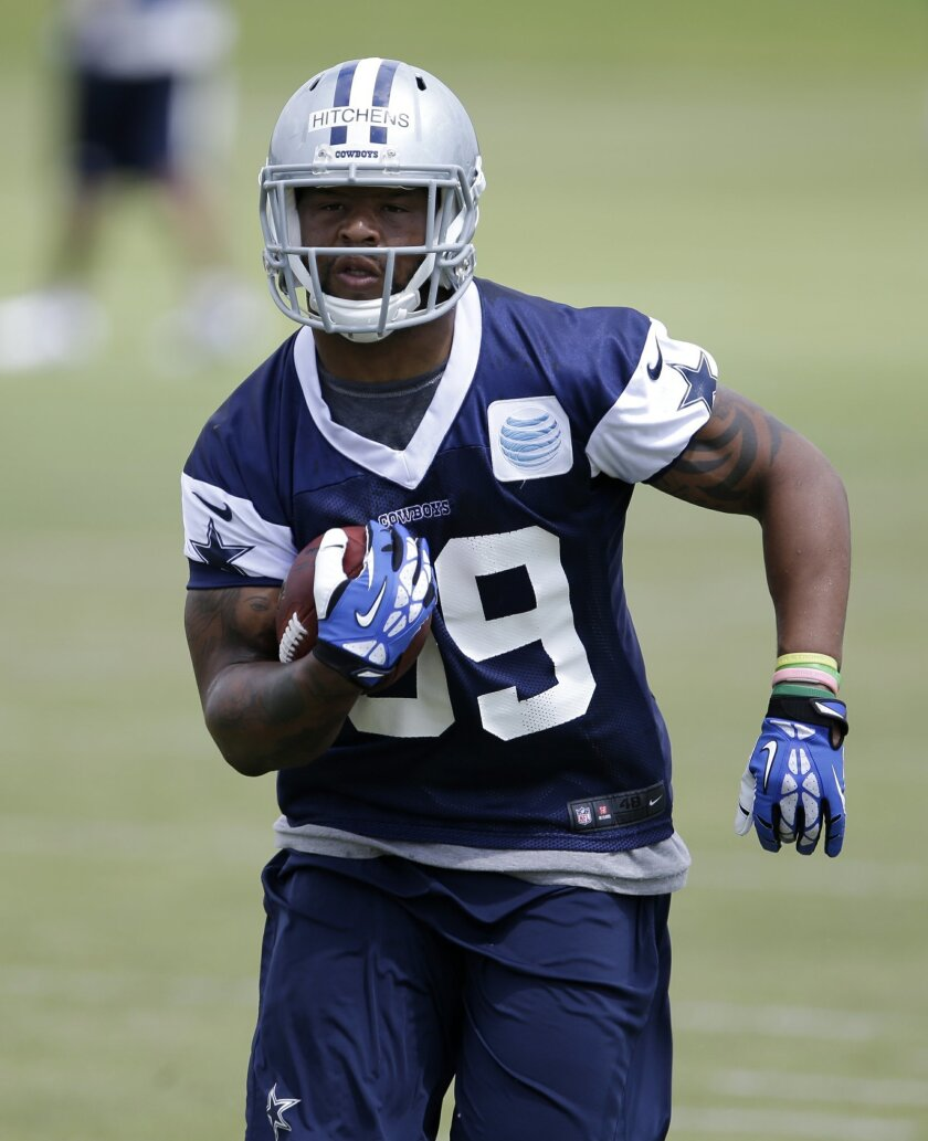 Dallas Cowboys linebacker Anthony Hitchens carries the ball in a drill during an NFL football organized team activity, Monday, June 2, 2014, in Irving, Texas. (AP Photo/Tony Gutierrez)