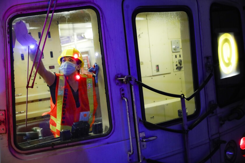 A contractor cleans an L.A. subway car on July 2.