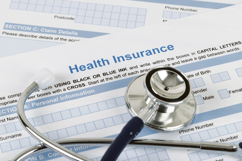 A health insurance form and a stethoscope