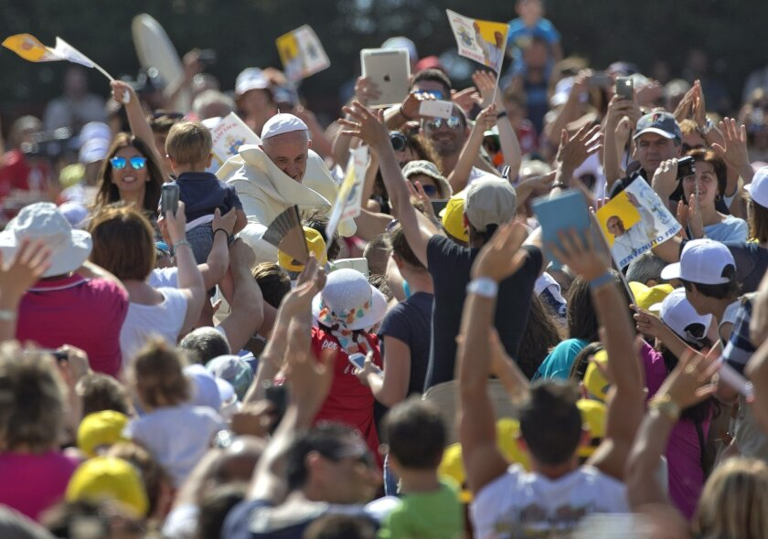 Faithful cheer as Pope Francis arrives to give a Mass in Campobasso, Italy, Saturday, July 5, 2014. Pope Francis is on a one day trip to the southern Italian region of Molise. (AP Photo/Alessandra Tarantino)