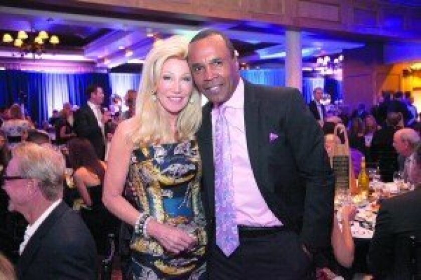 Event Co-Chair Madeleine Pickens with boxing legend Sugar Ray Leonard. Elegant Photography