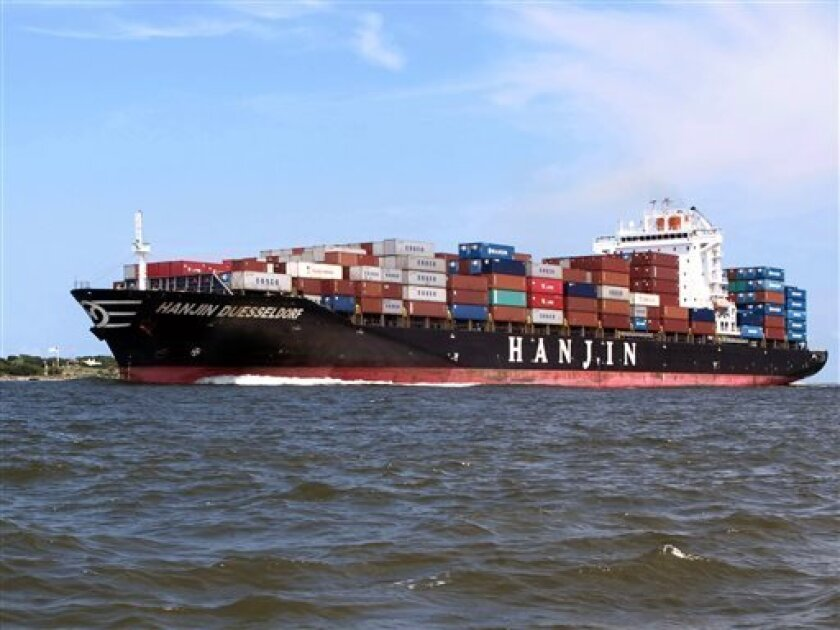 FILE - In this July 18, 2013, file photo, a container ship moves into the harbor in Charleston, S.C. The government reports how much wholesale businesses adjusted their stockpiles in July and how much they collected in sales on on Wednesday, Sept. 11, 2013. (AP Photo/Bruce Smith, File)