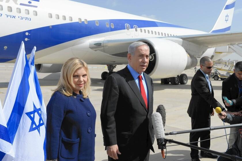 Israeli Prime Minister Benjamin Netanyahu and wife Sara prepare to depart Tel Aviv for Washington.