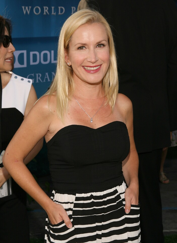 """Actress Angela Kinsey arrives at the """"Brave"""" premiere."""