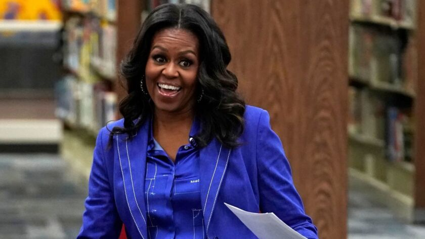 """Former First Lady Michelle Obama at Whitney M. Young Magnet High School in Chicago on Monday, the day before her already-bestselling book """"Becoming"""" was released."""