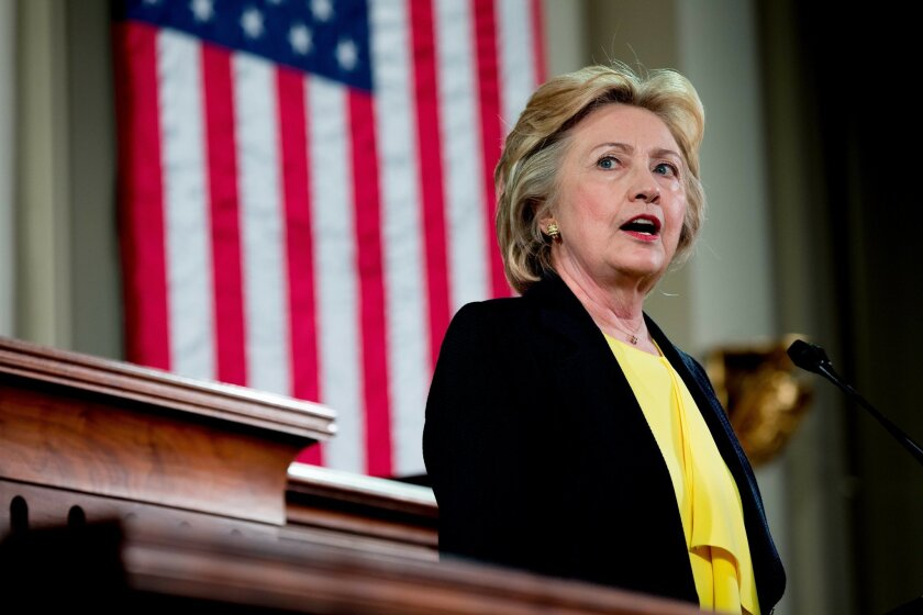 FILE - In this July 13, 2016 file photo, Democratic presidential candidate Hillary Clinton speaks in Springfield, Ill. The commercial airwaves show the two presidential candidates have drastically different views of the importance of traditional political campaigning. Trump says he sees little need