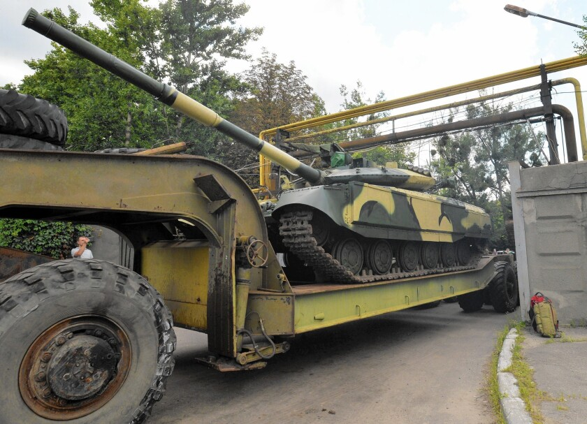 A truck carries a newly made Ukrainian tank from a factory in Kharkiv, in the country's northeast. Ukraine faces a dilemma in keeping its military exports out of Russian hands while preserving a major employment base.