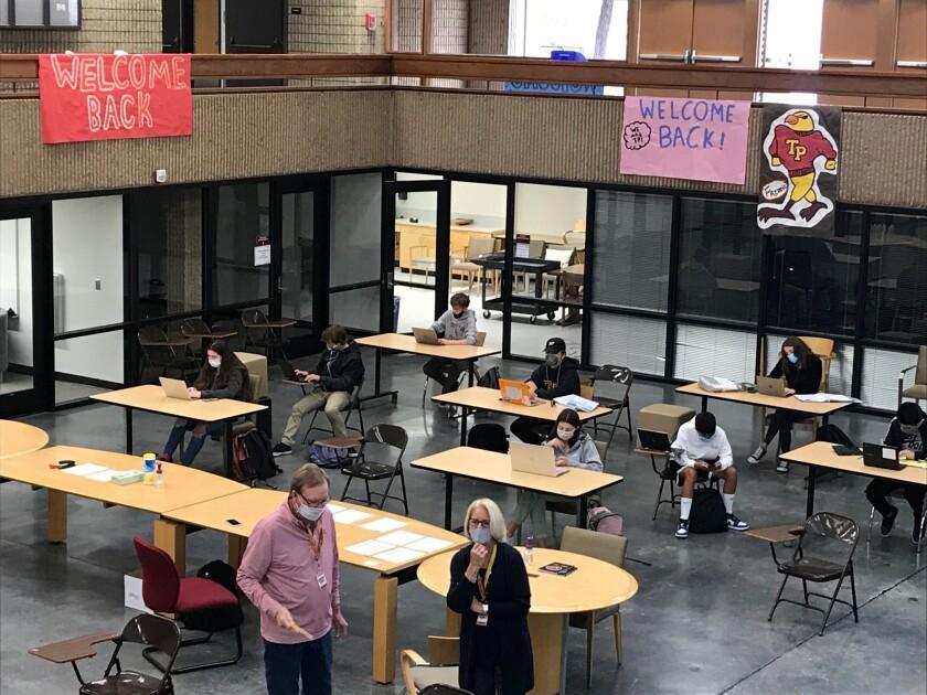 Students work inside the Torrey Pines High School's media center.