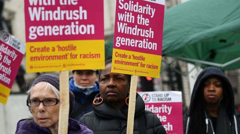 Protesters show their support for the so-called Windrush generation outside the Houses of Parliament in London on Monday.