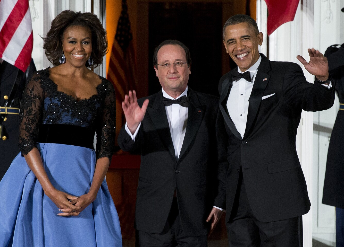 First lady Michelle Obama, left, and President Barack Obama welcome French President Francois Hollande for a State Dinner at the North Portico of the White House. The trip is taking place amid speculation about problems in Hollande's personal life.