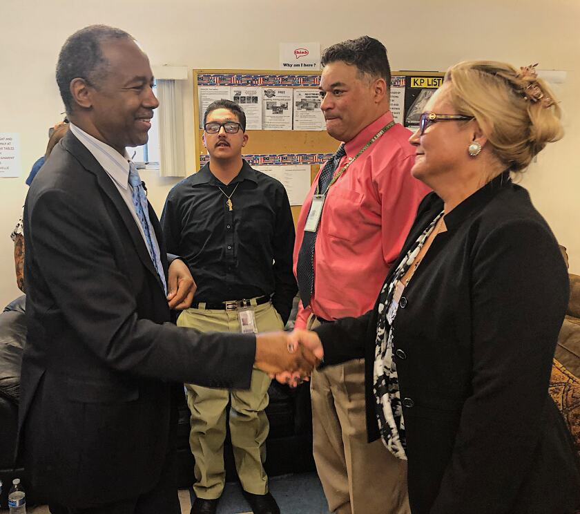HUD Secretary Ben Carson (left) shakes hands with Danelle Harrington, a program graduate at clinical intact coordinator at Veterans Village of San Diego on Thursday. Michael Taylor, standing next to her, is a resident at VVSD. Carson spent about two hours at the nonprofit during his visit.