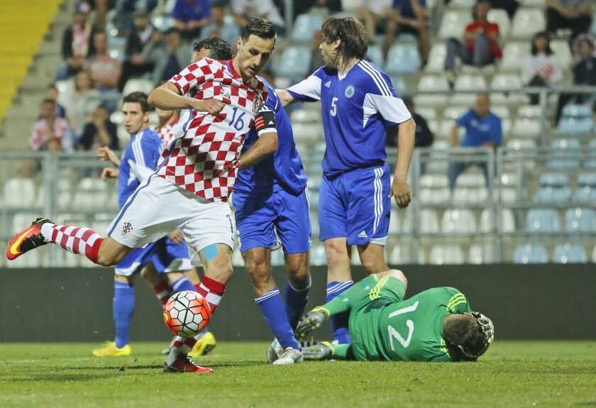 Croatia's Nikola Kalinic, left, shoots to score during the international friendly soccer match between Croatia and San Marino, in Rijeka, Croatia, Saturday, June 4, 2016. (AP Photo/Darko Bandic)