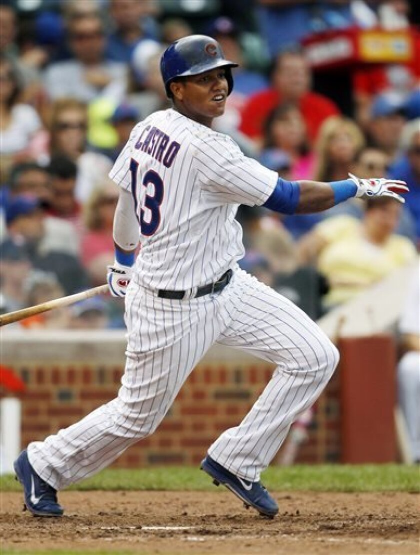 Chicago Cubs' Starlin Castro hits a double against the Philadelphia Phillies during the fourth inning of a baseball game on Saturday, Aug. 31, 2013, in Chicago. (AP Photo/Andrew A. Nelles)