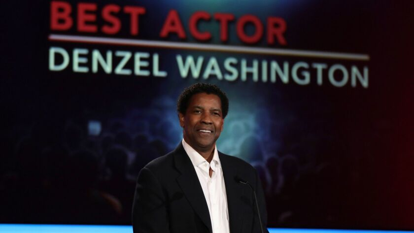 Denzel Washington accepts the award for best actor at AARP's 16th annual Movies for Grownups Awards.