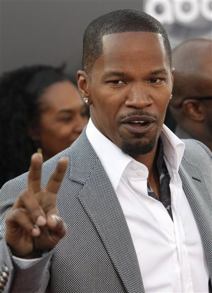 In this Nov. 23, 2008. file photo, Actor Jamie Foxx poses on the press line at the 2008 American Music Awards in Los Angeles. (AP Photo/Dan Steinberg, File)