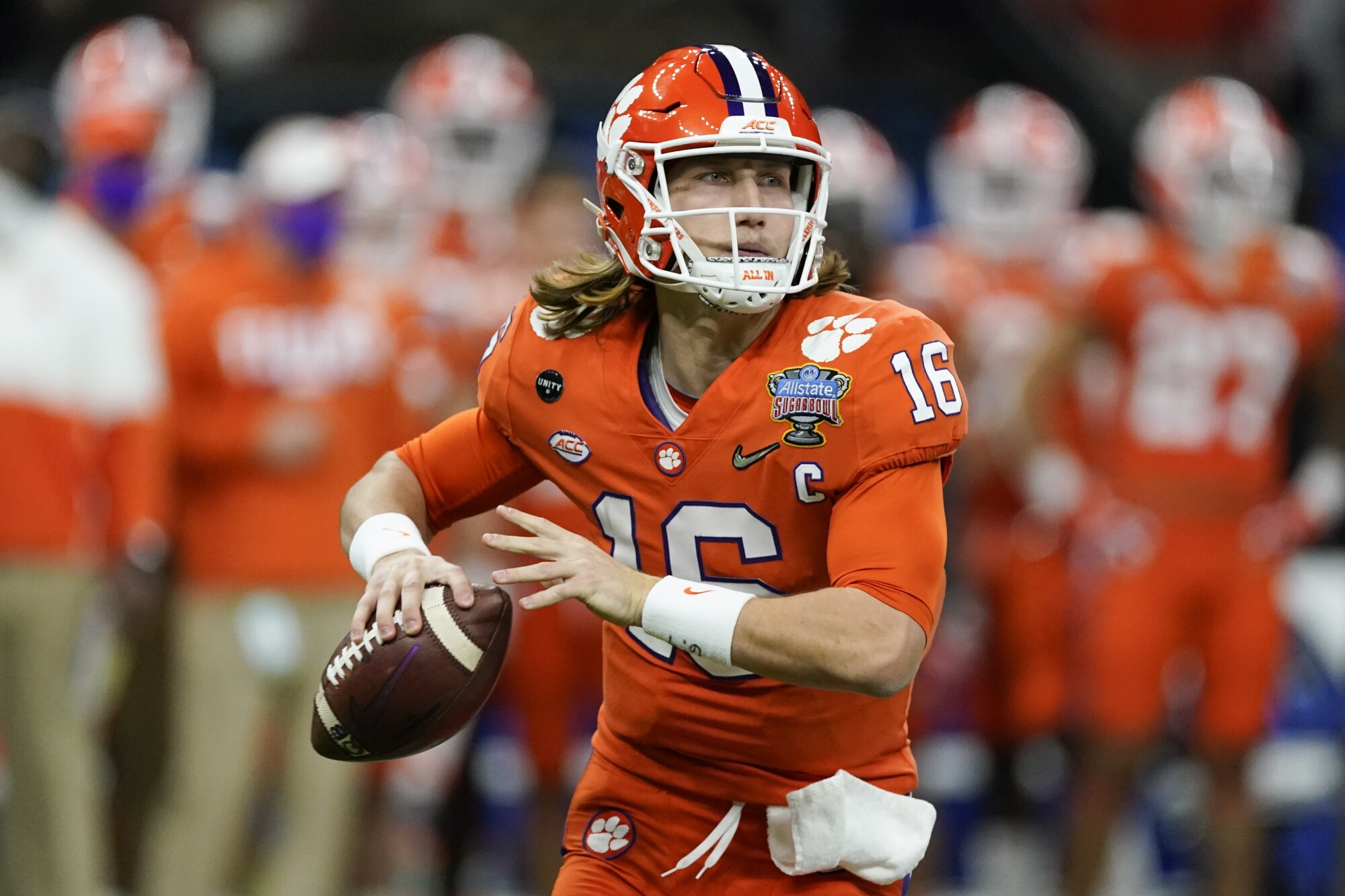 Clemson quarterback Trevor Lawrence looks to pass during a game.